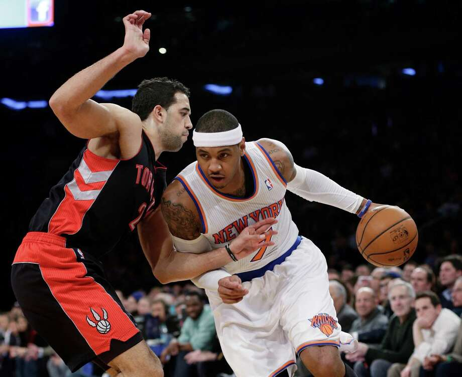 Toronto Raptors' Landry Fields, left, defends New York Knicks' Carmelo Anthony during the first half of an NBA basketball game Wednesday, Feb. 13, 2013, in New York. (AP Photo/Frank Franklin II) Photo: Frank Franklin II