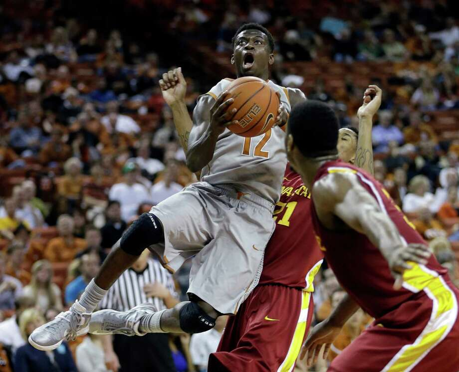 Texas' Myck Kabongo, soaring between Iowa State's Will Clyburn and Melvin Ejim, had 13 points and seven assists in his long-awaited season debut. Photo: Eric Gay, STF / AP