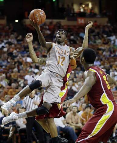 Texas' Myck Kabongo goes in for a layup as Iowa State's Melvin Ejim (3) looks on at the Erwin Center. Photo: Eric Gay / Associated Press
