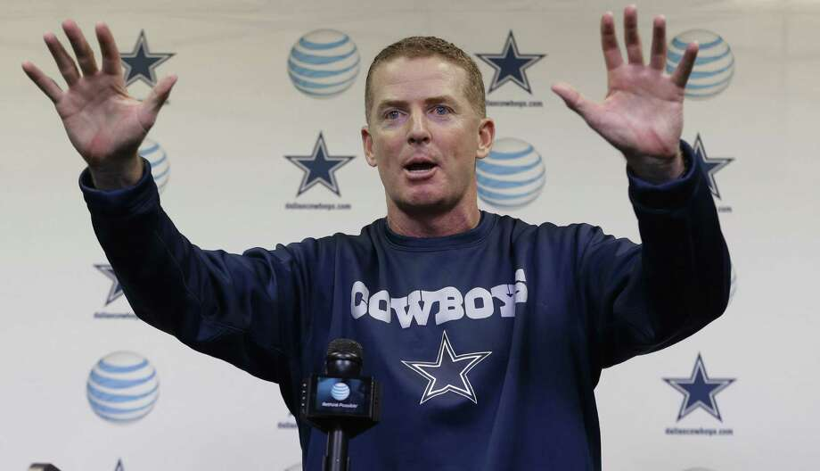 Cowboys coach Jason Garrett speaks to reporters and gestures Wednesday at the team's training facility in Irving. Photo: L.M. Otero / Associated Press