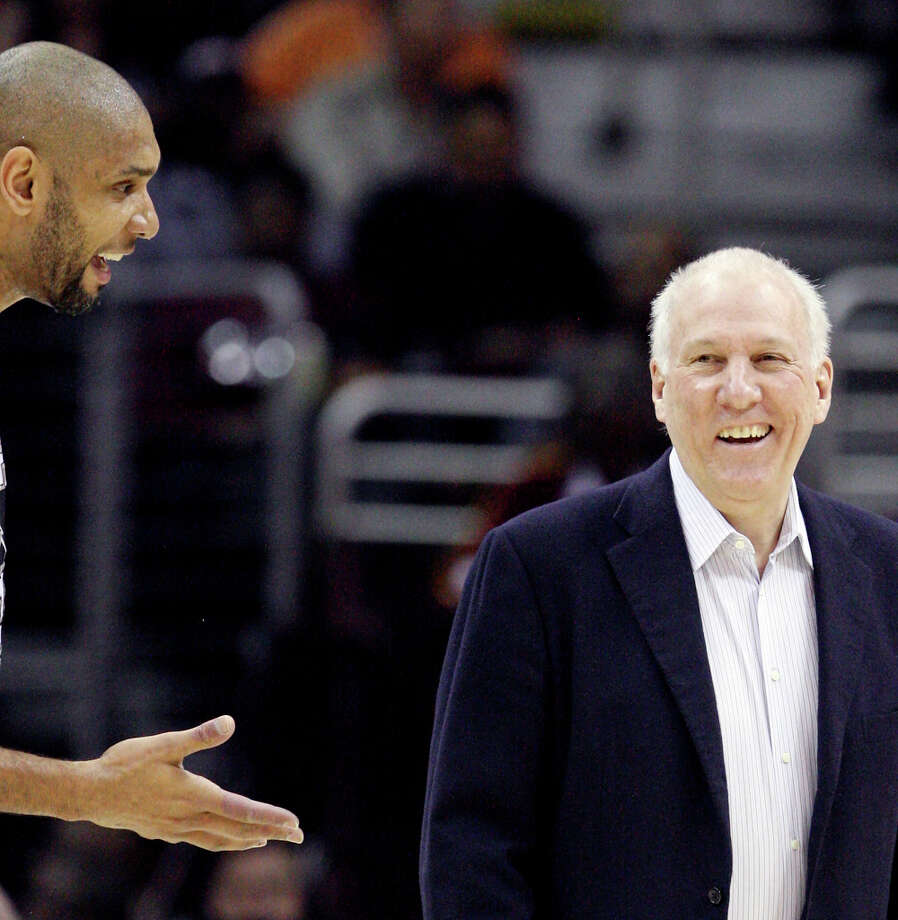 The Spurs' Tim Duncan and head coach Gregg Popovich joke during a timeout in first half action against the Cleveland Cavaliers Wednesday, Feb. 13, 2013, at the Quicken Loans Arena in Cleveland, Ohio. Photo: Edward A. Ornelas, San Antonio Express-News / © 2013 San Antonio Express-News
