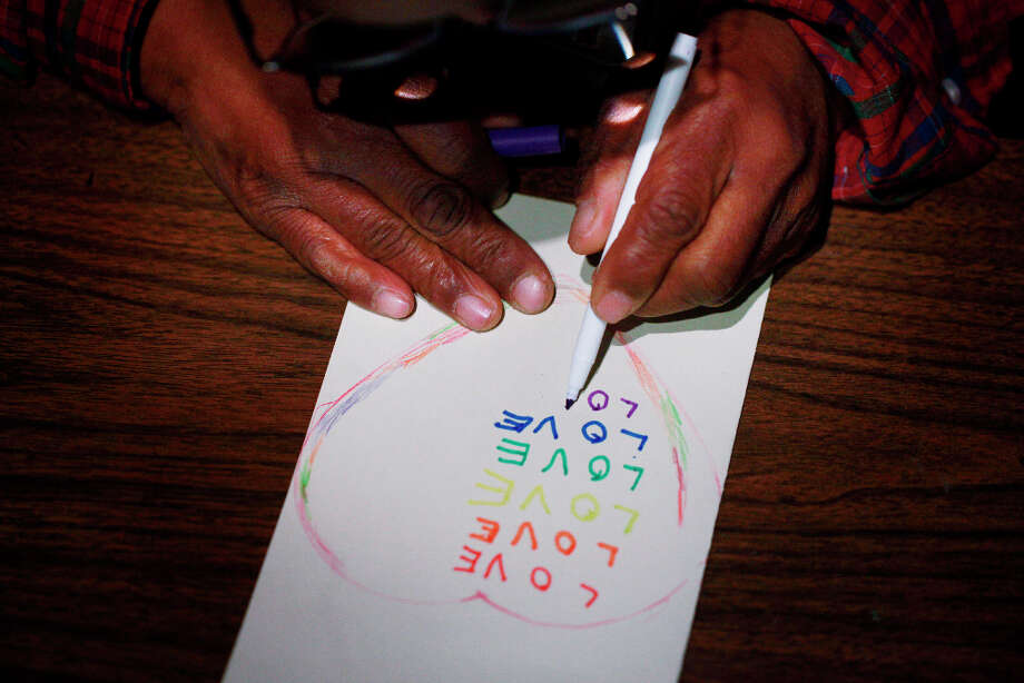 During art class at The Arc San Francisco, Donald Trammell  works on a valentine's card for his girlfriend Bonita on Tuesday Feb. 12, 2013 in San Francisco Calif.  Trammell, 51, and Abrams, 48, who met at The Arc San Francisco a non-profit that helps provide support for more than 600 clients with developmental disabilities, have been a couple for 15 years. Photo: Mike Kepka, The Chronicle / ONLINE_YES