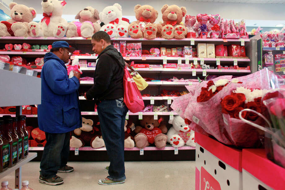 Donald Trammell and his girlfriend Bonita Abrams investigate Valentine's options in a downtown Walgreens on Wednesday Feb. 13, 2013 in San Francisco Calif. Trammell, 51, and Abrams, 48, who met at The Arc San Francisco a non-profit that helps provide support for more than 600 clients with developmental disabilities, have been a couple for 15 years. Photo: Mike Kepka, The Chronicle / ONLINE_YES