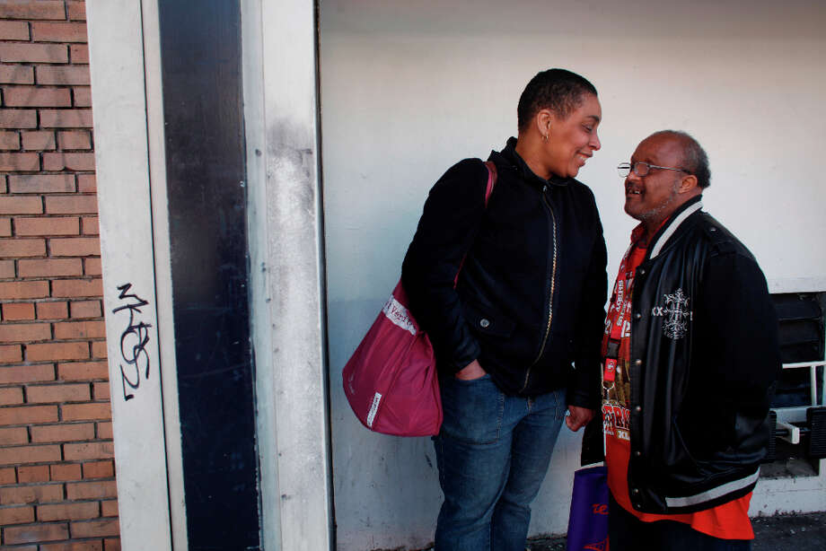 Bonita Abrams and her boyfriend Donald Trammell wait for the bus to take them home after spending the afternoon together at The Arc San Francisco on Tuesday Feb. 12, 2013 in San Francisco Calif. Trammell, 51, and Abrams, 48, who met at The Arc San Francisco where they are both clients, have been a couple for 15 years. Photo: Mike Kepka, The Chronicle / ONLINE_YES