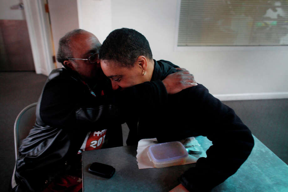After spending the day as a custodian downtown office building, Donald Trammell hugs his girlfriend Bonita Abrams on Tuesday Feb. 12, 2013 in San Francisco Calif.   Trammell, 51, and Abrams, 48, who met at The Arc San Francisco a non-profit that helps provide support for more than 600 clients with developmental disabilities, have been a couple for 15 years. Photo: Mike Kepka, The Chronicle / ONLINE_YES