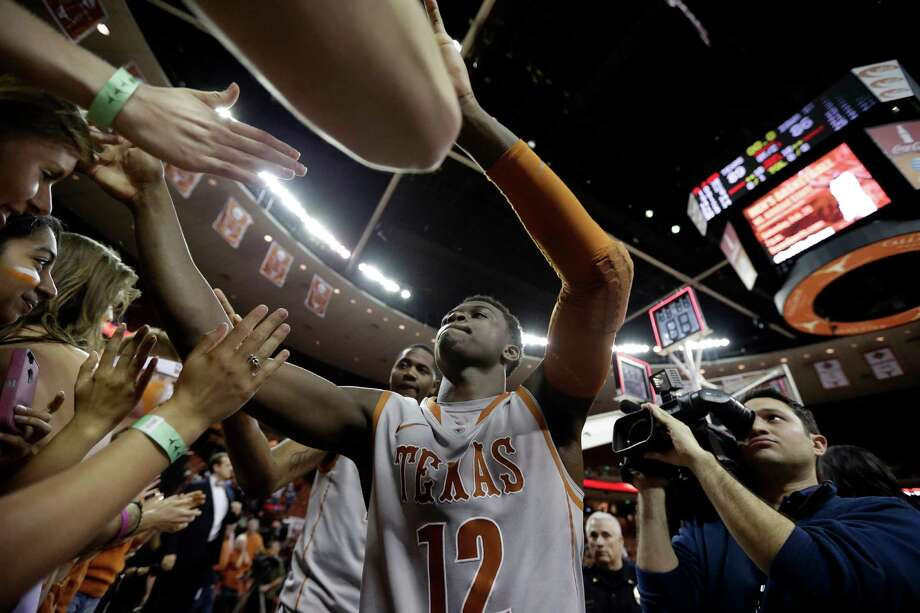 Texas' Myck Kabongo (12) celebrates with fans after the team's win over Iowa State in an NCAA college basketball game, Wednesday, Feb. 13, 2013, in Austin, Texas. (AP Photo/Eric Gay) Photo: Eric Gay, Associated Press / AP