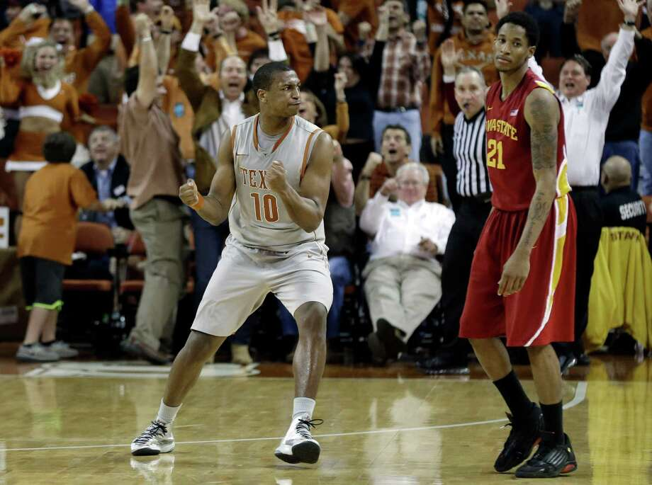 Texas' Jonathan Holmes (10) and Iowa State's Will Clyburn (21) react as Texas ties the game at the buzzer of regulation of an NCAA college basketball game, Wednesday, Feb. 13, 2013, in Austin, Texas. Texas won 89-86 in double overtime.  (AP Photo/Eric Gay) Photo: Eric Gay, Associated Press / AP