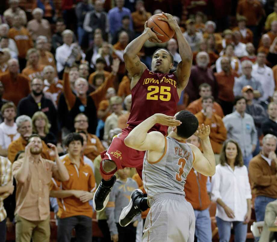 Iowa State's Tyrus McGee (25) shoots over Texas' Javan Felix (3) during overtime of an NCAA college basketball game, Wednesday, Feb. 13, 2013, in Austin, Texas. Texas won 89-86 in double overtime.  (AP Photo/Eric Gay) Photo: Eric Gay, Associated Press / AP