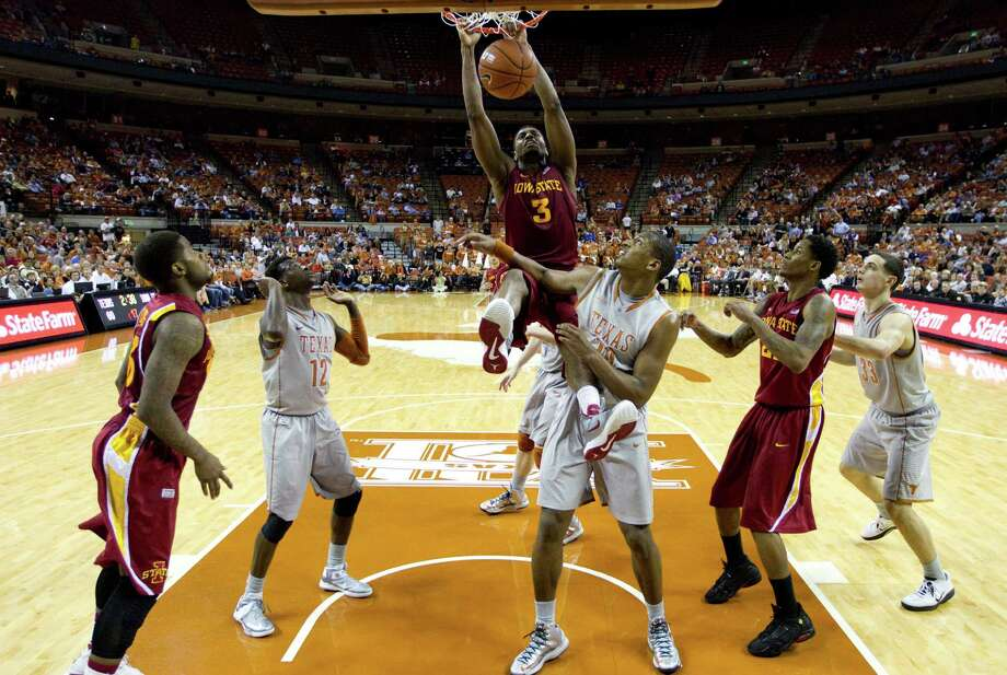Iowa State's Melvin Ejim (3) scores over Texas' Julien Lewis (14) during the second half of an NCAA college basketball game, Wednesday, Feb. 13, 2013, in Austin, Texas. Texas won 89-86 in double overtime.  (AP Photo/Eric Gay) Photo: Eric Gay, Associated Press / AP