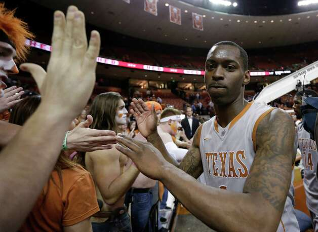 Texas' Sheldon McClellan, right, celebrates with fans after the team's double overtime win over Iowa State in an NCAA college basketball game, Wednesday, Feb. 13, 2013, in Austin, Texas. Texas won 89-86.  (AP Photo/Eric Gay) Photo: Eric Gay, Associated Press / AP