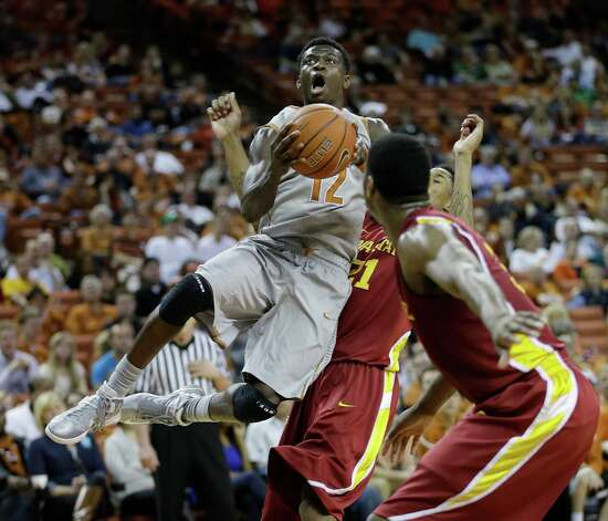 Texas' Myck Kabongo (12) bumps into Iowa State's Will Clyburn (21) as he shoots during the first half of an NCAA college basketball game, Wednesday, Feb. 13, 2013, in Austin, Texas. (AP Photo/Eric Gay) Photo: Eric Gay, Associated Press / AP