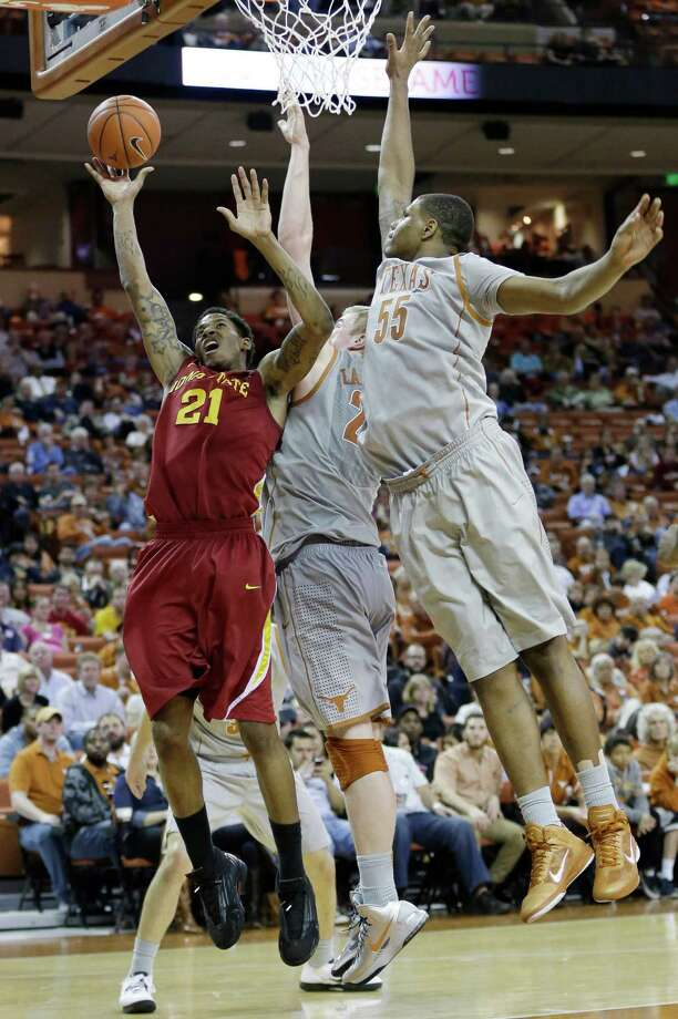 Iowa State's Will Clyburn (21) is defended by Texas' Cameron Ridley (55) and Connor Lammert, center, during the second half of an NCAA college basketball game, Wednesday, Feb. 13, 2013, in Austin, Texas. Texas won 89-86 in double overtime.  (AP Photo/Eric Gay) Photo: Eric Gay, Associated Press / AP