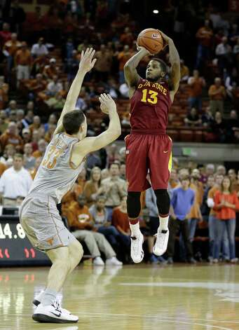 Iowa State's Korie Lucious (13) shoots over Texas' Ioannis Papapetrou (33) during overtime of an NCAA college basketball game, Wednesday, Feb. 13, 2013, in Austin, Texas. Texas won 89-86 in double overtime. Photo: Eric Gay, AP / AP