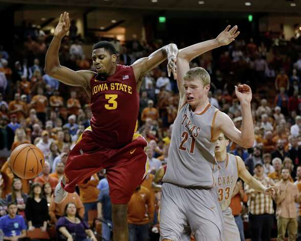 Iowa State's Melvin Ejim (3) and Texas' Connor Lammert (21) scramble for a loose ball during overtime of an NCAA college basketball game, Wednesday, Feb. 13, 2013, in Austin, Texas. Texas won 89-86 in double overtime.  (AP Photo/Eric Gay) Photo: Eric Gay, Associated Press / AP