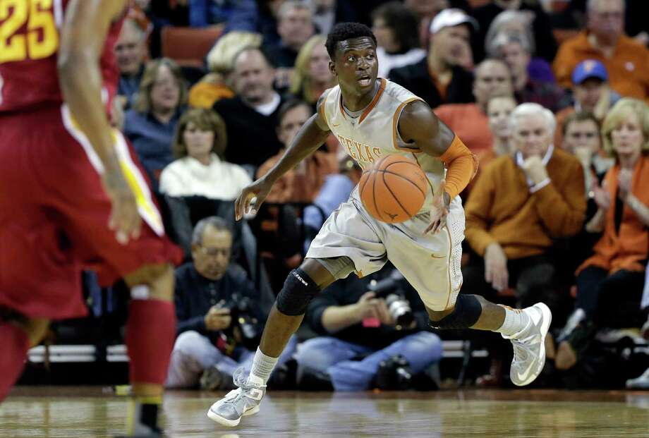 Texas' Myck Kabongo (12) moves the ball upcourt during the first half of an NCAA college basketball game against Iowa State, Wednesday, Feb. 13, 2013, in Austin, Texas. Kabongo returned for his first game of the season after a 23-game NCAA suspension. (AP Photo/Eric Gay) Photo: Eric Gay, Associated Press / AP