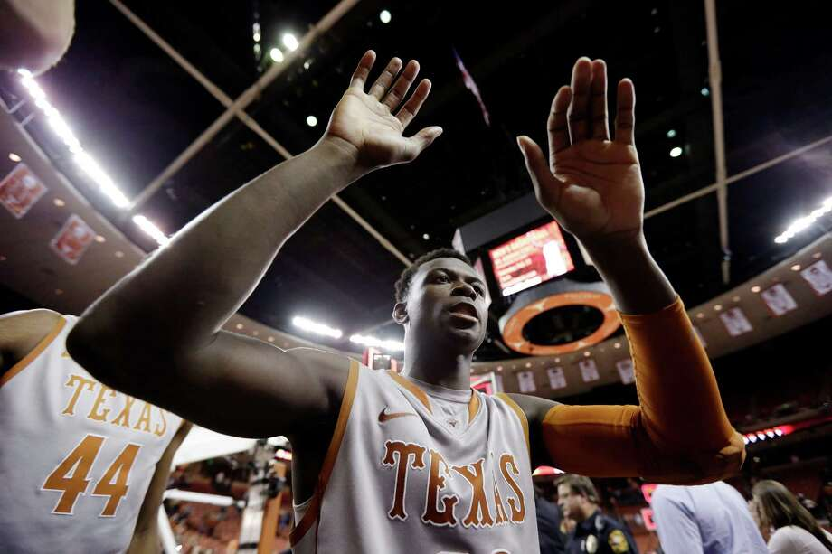 Texas' Myck Kabongo celebrates the team's double overtime win over Iowa State in an NCAA college basketball game, Wednesday, Feb. 13, 2013, in Austin, Texas. Texas won 89-86.  (AP Photo/Eric Gay) Photo: Eric Gay, Associated Press / AP