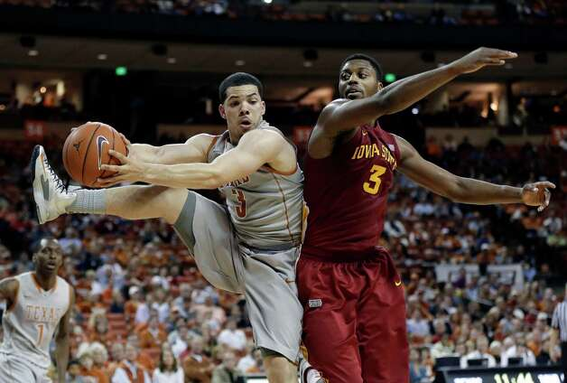Texas' Javan Felix, left, and Iowa State's Melvin Ejim, right, scramble for a rebound during the second half of an NCAA college basketball game, Wednesday, Feb. 13, 2013, in Austin, Texas. Texas won 89-86 in double overtime.  (AP Photo/Eric Gay) Photo: Eric Gay, Associated Press / AP