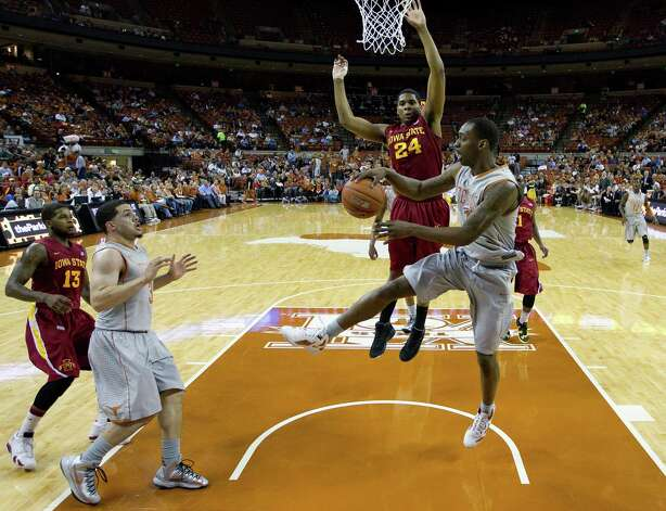 Texas' Sheldon McClellan, right, tries to pass as Iowa State's Percy Gibson (24) defends him during the first half of an NCAA college basketball game, Wednesday, Feb. 13, 2013, in Austin, Texas. (AP Photo/Eric Gay) Photo: Eric Gay, Associated Press / AP