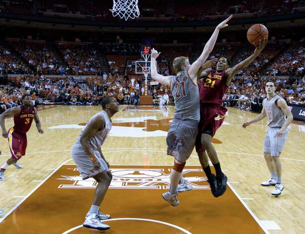 Iowa State's Will Clyburn, second from right, shoots over Texas' Connor Lammert, center, during the second half of an NCAA college basketball game, Wednesday, Feb. 13, 2013, in Austin, Texas. Texas won 89-86 in double overtime.  (AP Photo/Eric Gay) Photo: Eric Gay, Associated Press / AP