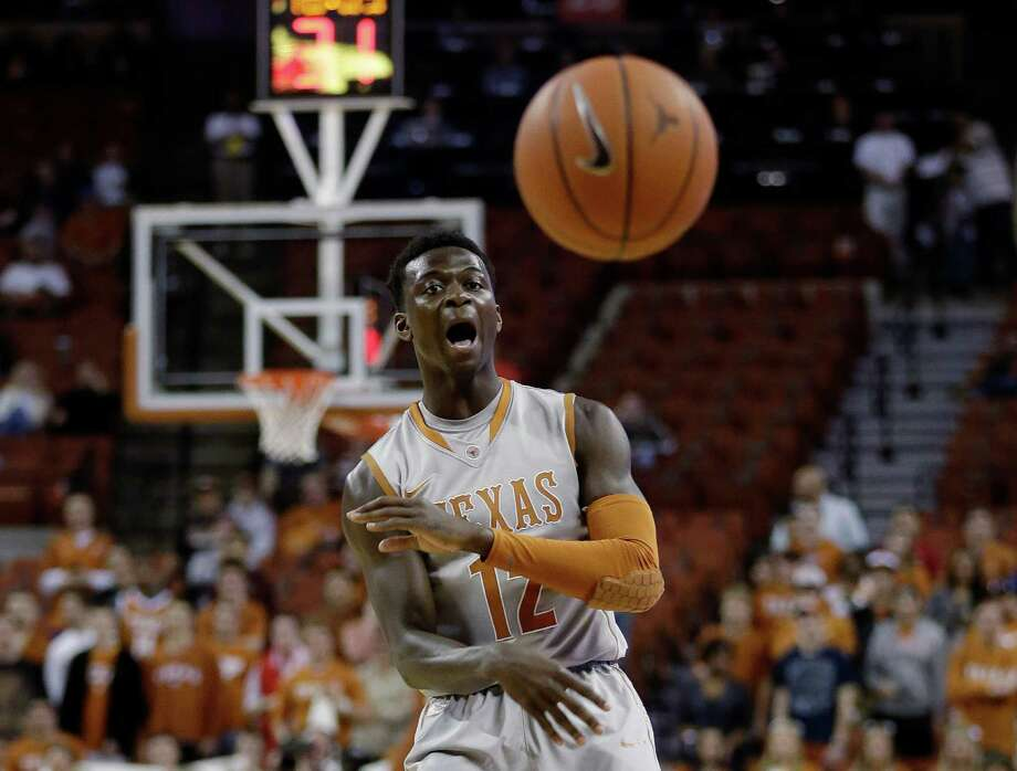 Texas' Myck Kabongo (12) passes to a teammate during the first half of an NCAA college basketball game against Iowa State, Wednesday, Feb. 13, 2013, in Austin, Texas. Kabongo returned for his first game of the season after a 23-game NCAA suspension. (AP Photo/Eric Gay) Photo: Eric Gay, Associated Press / AP