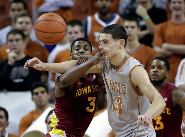 Iowa State's Melvin Ejim (3) and Texas' Ioannis Papapetrou (33) scramble for a rebound during the first half of an NCAA college basketball game, Wednesday, Feb. 13, 2013, in Austin, Texas. (AP Photo/Eric Gay) Photo: Eric Gay, Associated Press / AP