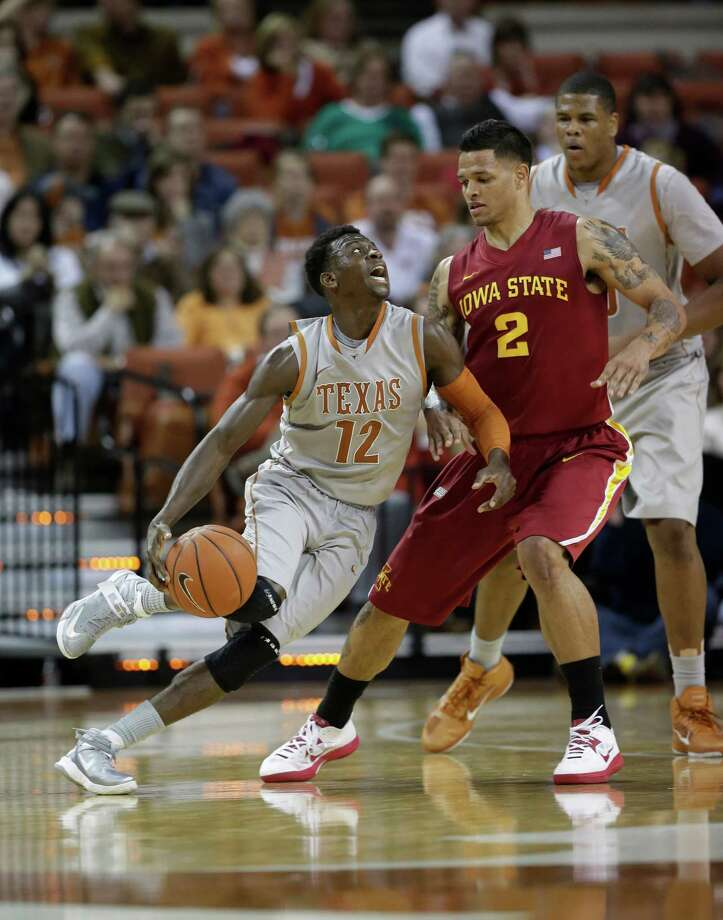 Texas' Myck Kabongo (12) drives on Iowa State's Chris Babb (2) during the second half of an NCAA college basketball game, Wednesday, Feb. 13, 2013, in Austin, Texas. Texas won 89-86 in double overtime.  (AP Photo/Eric Gay) Photo: Eric Gay, Associated Press / AP