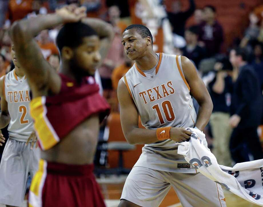 Texas' Jonathan Holmes (10) celebrates the team's double overtime win over Iowa State in an NCAA college basketball game, Wednesday, Feb. 13, 2013, in Austin, Texas. Texas won 89-86.  (AP Photo/Eric Gay) Photo: Eric Gay, Associated Press / AP