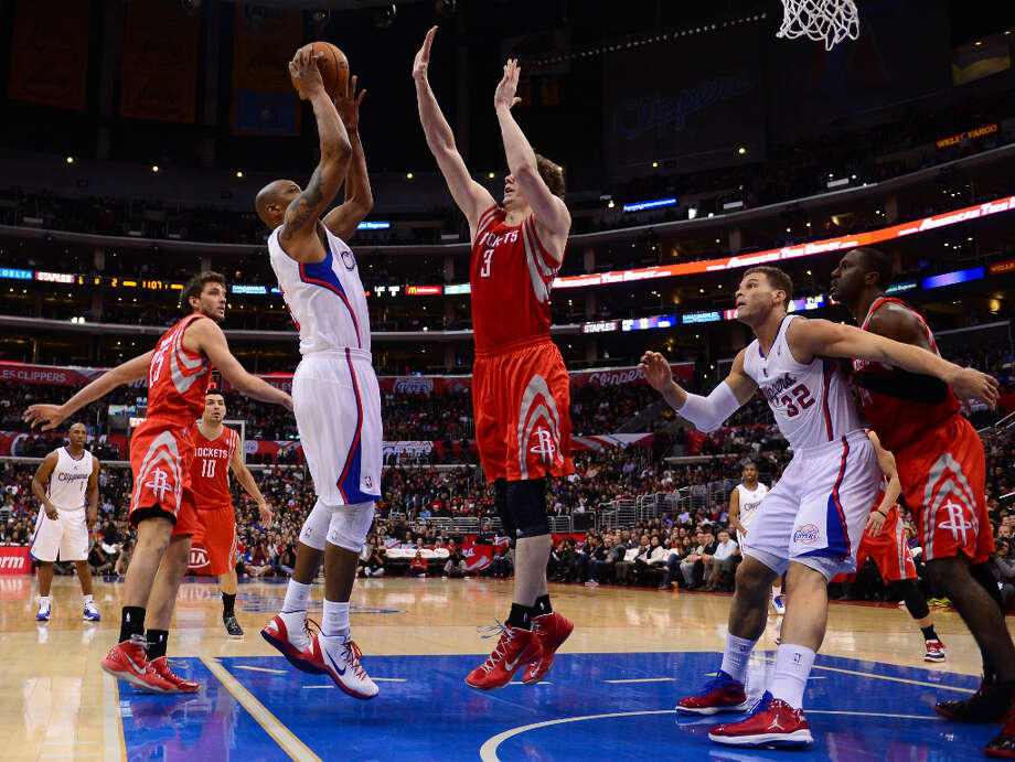Feb. 13: Clippers 106, Rockets 96Caron Butler of the Clippers shoots against Omer Asik. Photo: FREDERIC J. BROWN, AFP/Getty Images / AFP