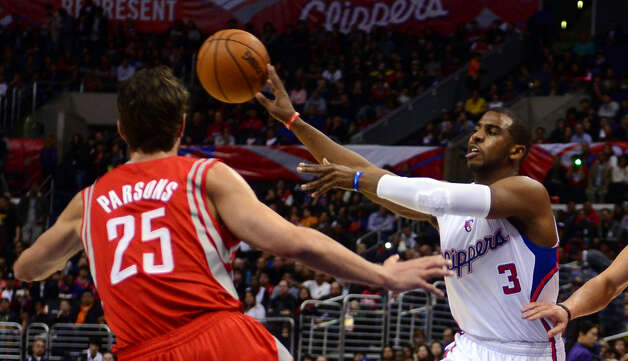 Chris Paul of the Clippers is guarded by Chandler Parsons. Photo: FREDERIC J. BROWN, AFP/Getty Images / AFP