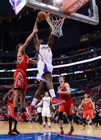 DeAndre Jordan of the Clippers goes to the basket against Chandler Parsons. Photo: FREDERIC J. BROWN, AFP/Getty Images / AFP