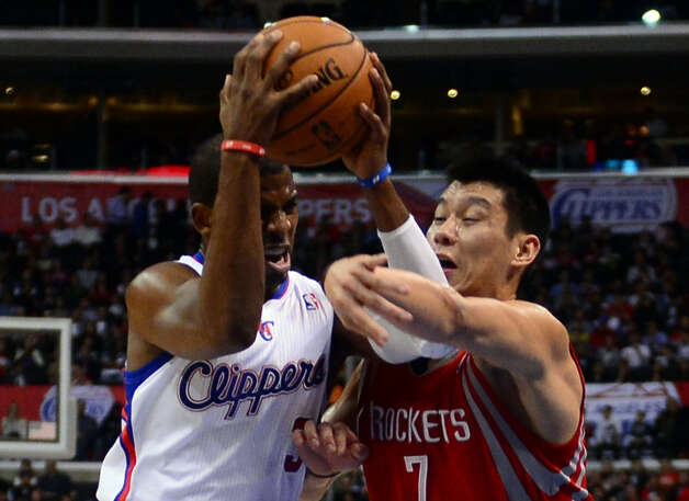 Chris Paul of the Clippers is guarded by Jeremy Lin of the Rockets. Photo: FREDERIC J. BROWN, AFP/Getty Images / AFP