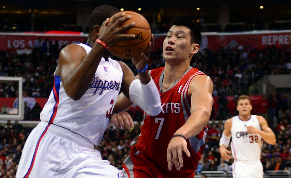 Chris Paul of the Clippers is guarded by Jeremy Lin of the Rockets.