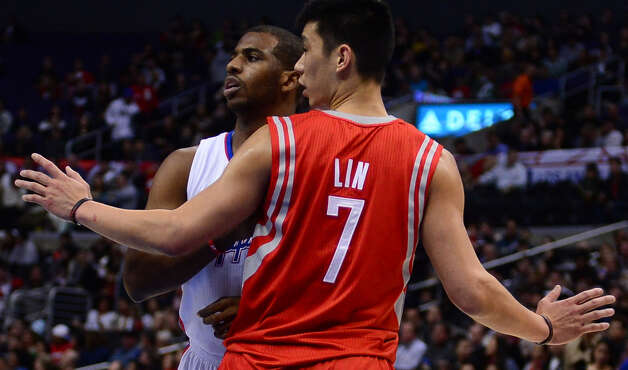 Chris Paul of the Clippers and Jeremy Lin of the Rockets stop the action on court. Photo: FREDERIC J. BROWN, AFP/Getty Images / AFP