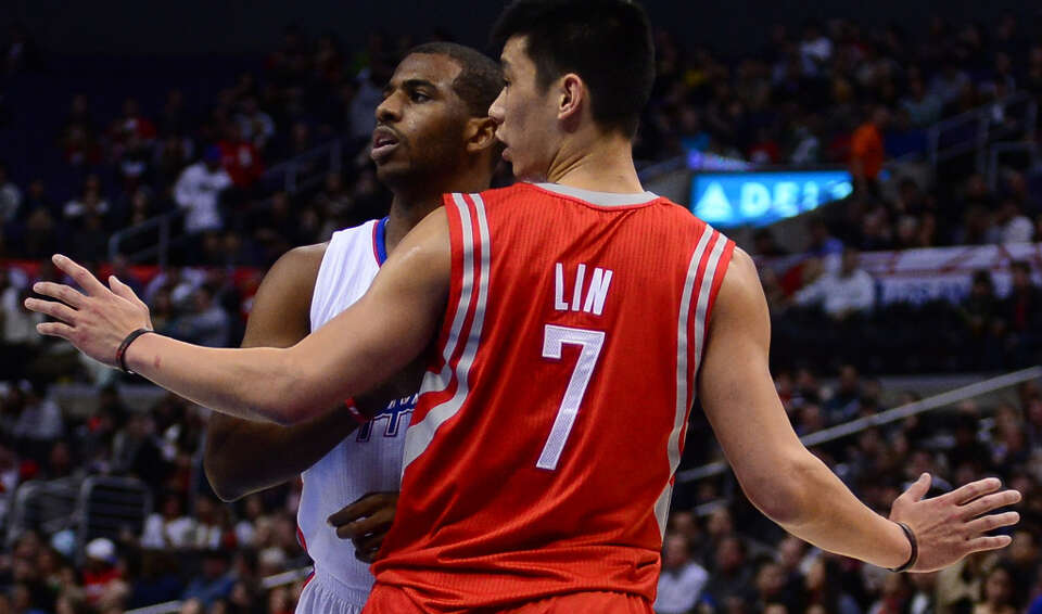 Chris Paul of the Clippers and Jeremy Lin of the Rockets stop the action on court.