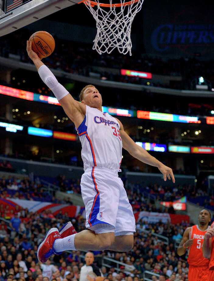 Clippers forward Blake Griffin goes up for a shot as Rockets forward Patrick Patterson watches. Photo: Mark J. Terrill, Associated Press / AP
