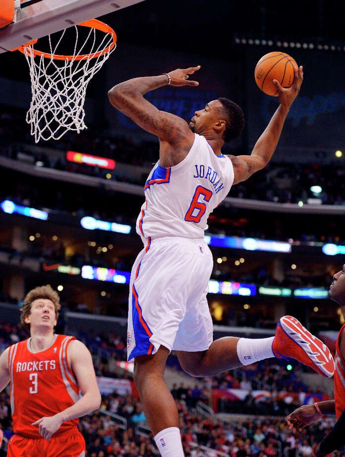 Clippers center DeAndre Jordan dunks as Rockets center Omer Asik watches. Photo: Mark J. Terrill, Associated Press / AP