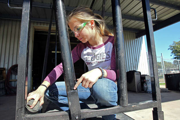 Abby Snyder works on finishing her cattle trim chute  as O'Connor High School students participate in the rodeo's Junior Ag Mechanics contest. February 13, 2013. Photo: Tom Reel