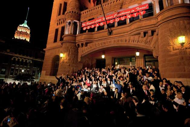 Couples take part in a Valentine's Day mass wedding on the steps of the Bexar County Courthouse.  Photo: Darren Abate, For The Express-News