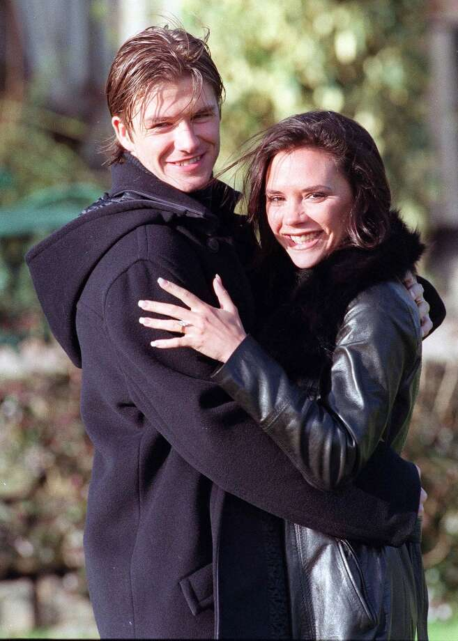 David Beckham and Victoria Adams, aka Posh and Becks, pose for photographers after the announcement of their engagement on January 25, 1998, in Chester, United Kingdom. Photo: Dave Hogan, Getty Images / 1998 Getty Images