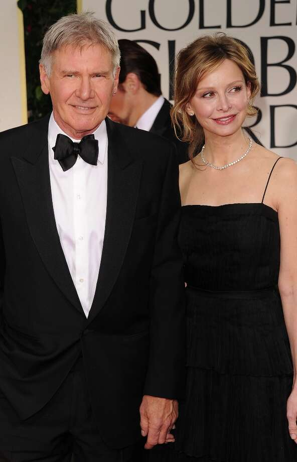Harrison Ford and Calista Flockhart began dating in 2002 after meeting at the Golden Globe Awards. They married in 2010 and are parents to Flockhart's adopted son. Ford has four grown children from previous marriages.  Photo: Jason Merritt, Getty Images / 2012 Getty Images