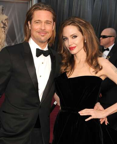 Brad Pitt and Angelina Jolie met while filming 2005's Mr. & Mrs. Smith, while Pitt was married to Jennifer Aniston. They began seeing each other after Pitt's divorce from Aniston was finalized, though neither confirmed the relationship until Jolie announced she was pregnant with the couple's child in 2006. They have six kids together and are engaged. Photo: Steve Granitz, WireImage / 2012 Steve Granitz