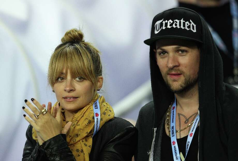 Nicole Richie — fashion designer/daughter of Lionel Richie — and Good Charlotte musician began dating in 2006. They welcomed two kids in 2008 and 2009 and then married in 2010. Photo: Cameron Spencer, Getty Images / 2012 Getty Images