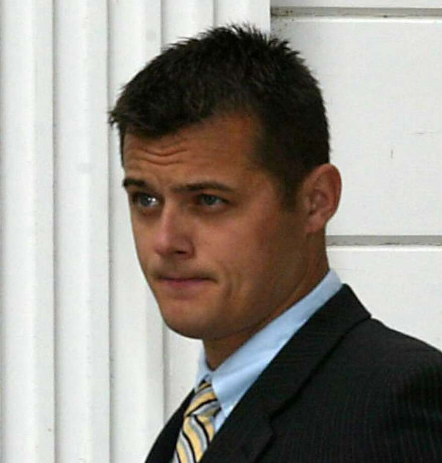 Jared Rohrig of Milford. Rohrig, a suspended Orange police officer, leaves Milford Superior Court on Sept. 8th, 2009 after being arraigned on rape charges. Rohrig allegedly tried to pass himself off as his twin brother during an encounter with his brother's girlfriend. Photo: Phil Noel / Connecticut Post