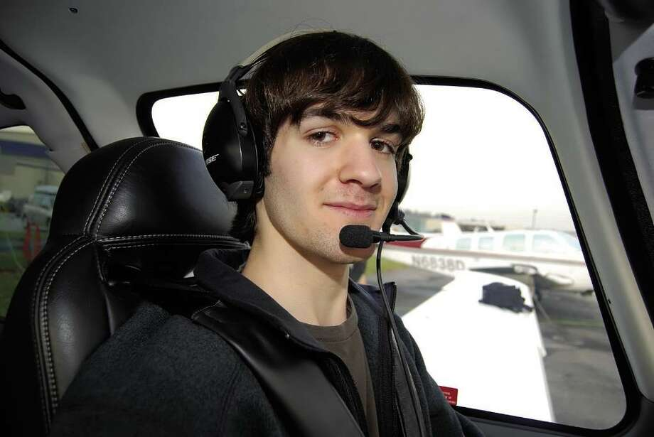 Alex Yudkovitz in the pilot's seat of a grounded airplane at the Westchester County Airport. Yudkovitz, a 17-year-old New Canaan High School junior, is a newly licensed pilot. Photo: Brittany Lyte /Staff Photo / Stamford Advocate