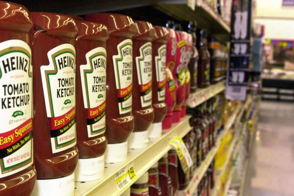 "Heinz ketchup, in  ""upside down"" bottles, rests on a shelf in a grocery store in Cranberry, Pa. on Tuesday, March 11, 2003. H.J. Heinz Co., the Pittsburgh-based ketchup maker reported that earnings fell to $151.6 million, or 43 cents per share, in the three months ending Jan. 29, compared with $201.7 million, or 57 cents per share, in the same period a year ago."