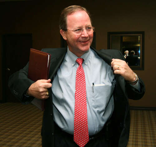 Republican Bill Flores puts on his coat before watching election results, Tuesday, Nov. 2, 2010, in Bryan, Texas. Flores is running against U.S. Rep. Chet Edwards, D-Texas, for the Texas 17th District seat. Photo: Duane A. Laverty, AP / Waco Tribune Herald