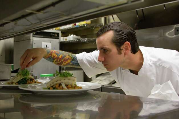"Chef Chris Cook puts finishing touches on his creation during Food Network's ""Chef Wanted."""