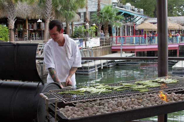 "Chef Chris cooking on the grill at Abels on the Lake in Austin; as seen on Food Network's ""Chef Wanted"" with Anne Burrell."