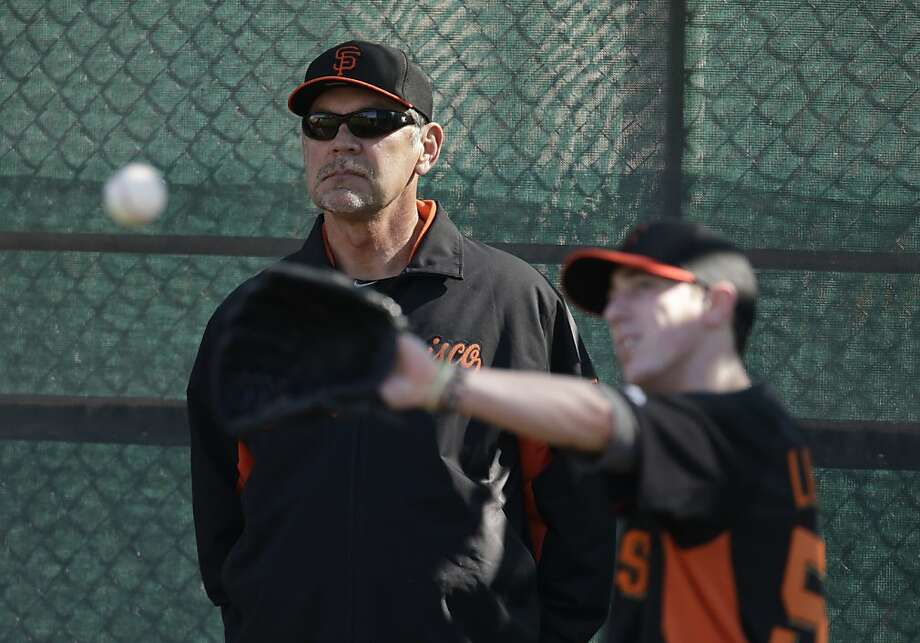 San Francisco Giants' Bruce Bochy watches Tim Lincecum during a spring training baseball workout Wednesday, Feb. 13, 2013, in Scottsdale, Ariz. (AP Photo/Darron Cummings) Photo: Darron Cummings, Associated Press