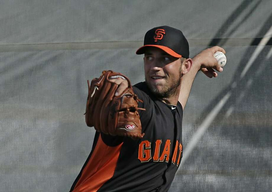 San Francisco Giants' Madison Bumgarner throws during a spring training baseball workout Wednesday, Feb. 13, 2013, in Scottsdale, Ariz. (AP Photo/Darron Cummings) Photo: Darron Cummings, Associated Press